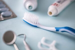 close up of toothbrush and dental tools